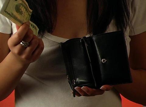 Beautiful Young Woman Puts a Twenty-dollar Bill in Stock Video Footage