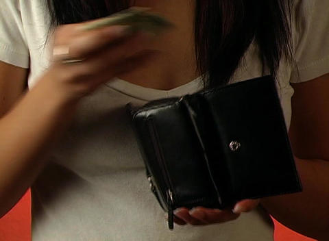 Beautiful Young Woman Puts a Twenty-dollar Bill in Footage