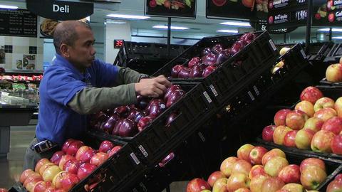 Man Facing Apples In Produce Stock Video Footage