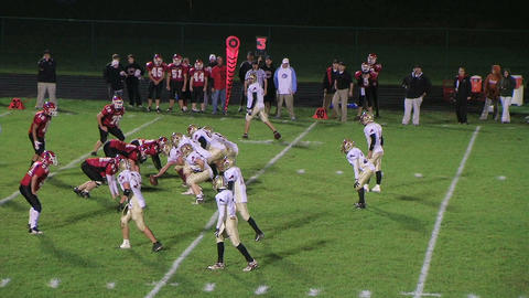 Football Reception and Tackle Stock Video Footage