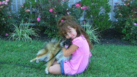 Girl Hugging Dog and Smiling Stock Video Footage