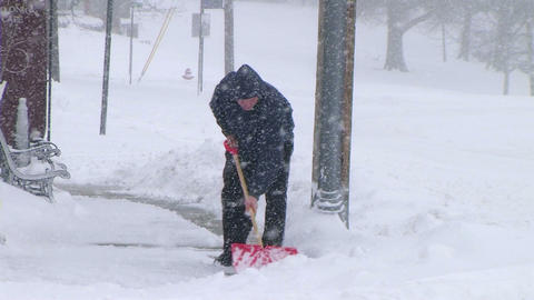 Man Shoveling Snow 02 Stock Video Footage