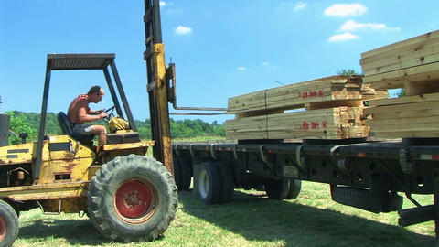 Forklift Unloading Construction Lumber 02 Stock Video Footage