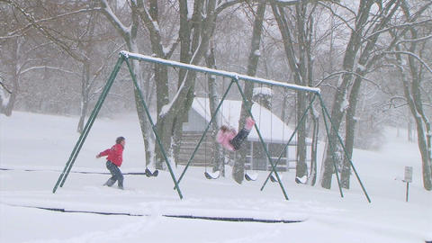 Girl Swinging in Snow Stock Video Footage