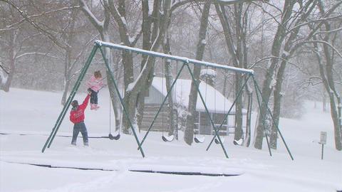 Girl Swinging in Snow Stock Video Footage