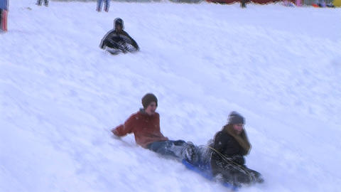 Teenagers Sled Riding Stock Video Footage