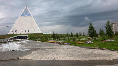 Pyramid, fountain, dramatic sky Stock Video Footage