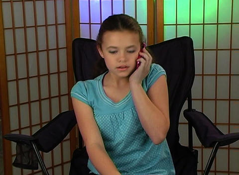 Beautiful Adolescent Girl Talks on Her Cell Phone  Live Action