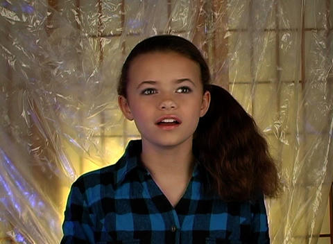 Beautiful Adolescent Girl Laughs and Rolls Her Eye Stock Video Footage