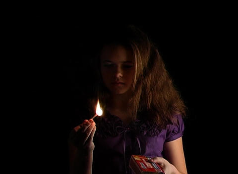 Beautiful Adolescent Girl Lights a Match (1) Footage