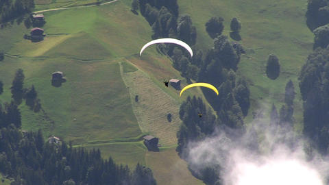 paraglider overtakes another Stock Video Footage