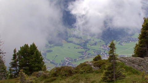 time lapse clouds over austrian valley Stock Video Footage