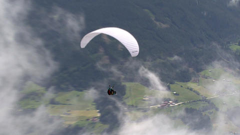 zoom to paraglider close Stock Video Footage