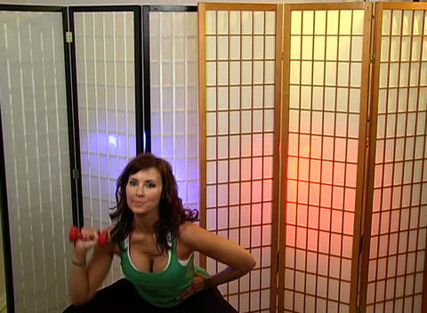 Beautiful Brunette Working Out with a Hand Weight Stock Video Footage