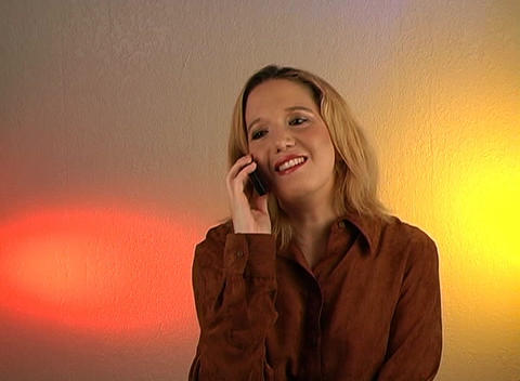 Beautiful Blonde Talking on a Cell Phone (2) Stock Video Footage
