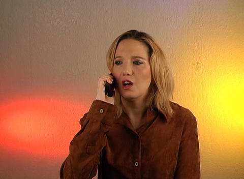 Beautiful Blonde Talking on a Cell Phone (4) Stock Video Footage