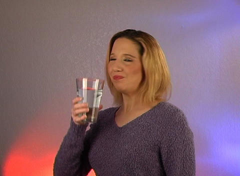 Beautiful Young Blonde Drinks a Glass of Water Stock Video Footage