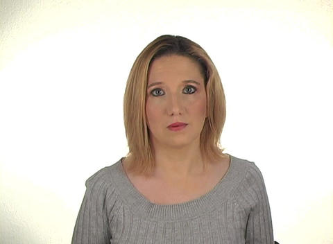 Beautiful Young Blonde Shrugs Her Shoulders Stock Video Footage