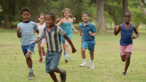 Children Playing Football In Park Slow Motion stock footage