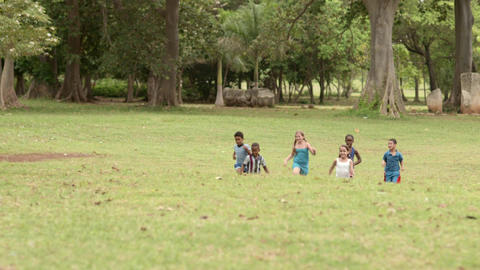 Happy Kids Playing Football In Park stock footage