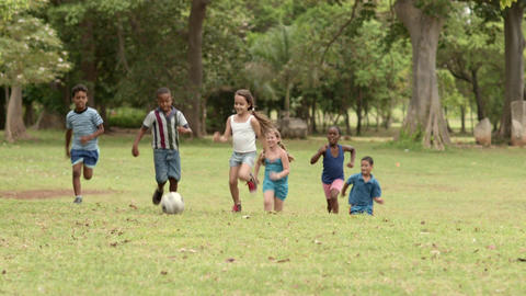 Happy Kids Playing Football in Park Footage