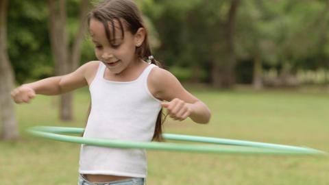 Little Girl Playing Hula Hoop Footage