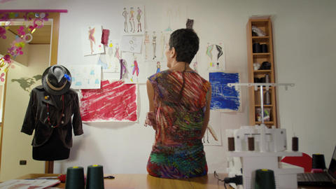 Woman Working As Fashion Designer Contemplating Drawings Footage