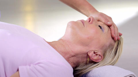 Therapist Doing Reiki Therapy And Mature Woman Rel stock footage