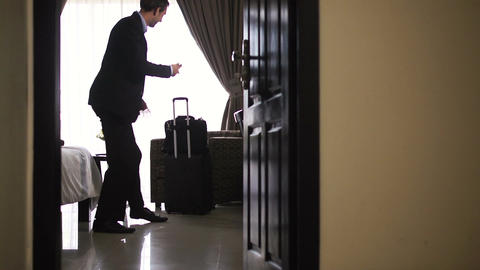 Businessman Leaving Hotel Room stock footage