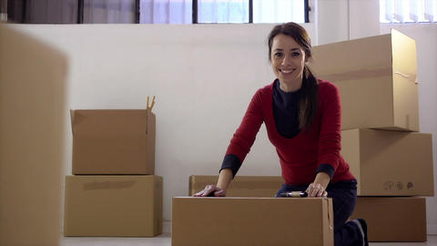 Woman Packing Cardboard Boxes Stock Video Footage