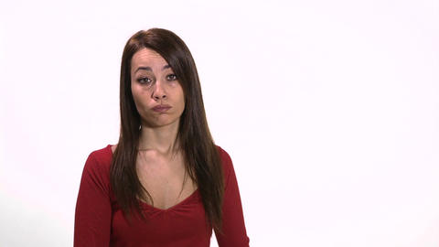 Woman holding sad face emoticon Stock Video Footage