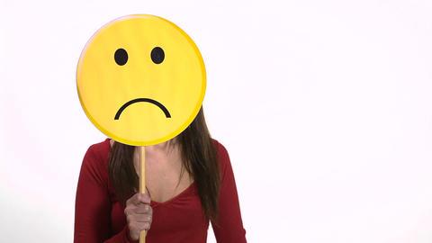 Woman holding sad face emoticon Footage