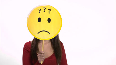 Woman holding question marks face emoticon Footage