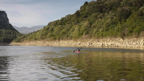 Tourist Canoeing In Lake, Sardinia, Italy Stock Video Footage