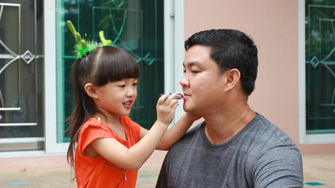 Little girl makeup to papa Stock Video Footage