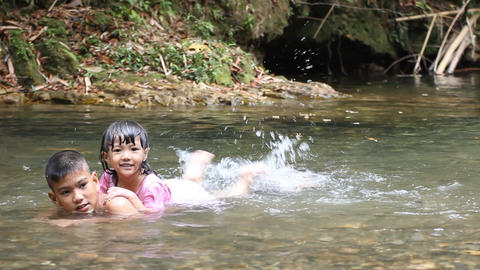 kids play in the stream Footage