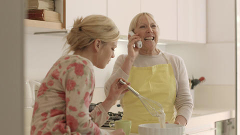 Mom And Daughter Cooking In Kitchen stock footage