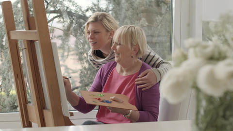 Senior Woman And Daughter Painting Footage
