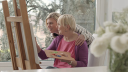 Senior Woman And Daughter Painting Stock Video Footage