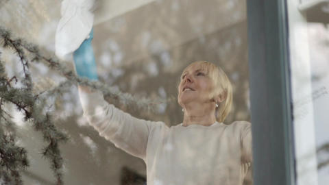 Senior Woman Doing Chores At Home Footage