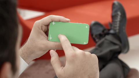 Man typing on smartphone with green screen Footage
