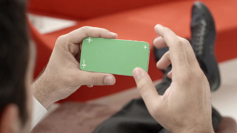 Man typing on smartphone with green screen Stock Video Footage