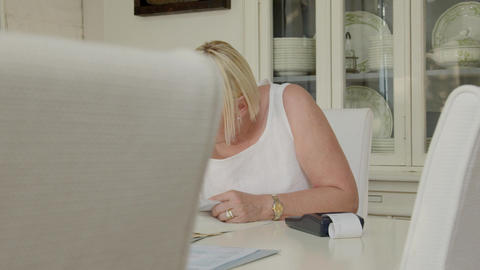 Senior woman checking bills and doing budget at home Stock Video Footage