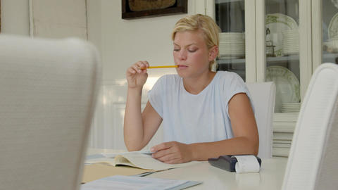 Young woman checking bills and doing budget at home Stock Video Footage