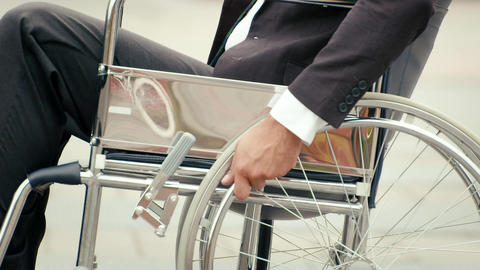 Portrait of happy businessman on wheelchair Stock Video Footage