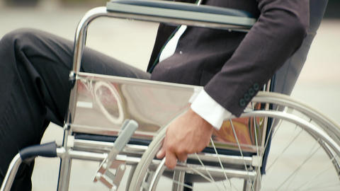 Portrait of happy businessman on wheelchair Footage