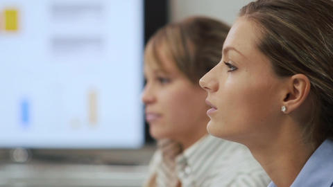 Two businesswomen talking in meeting at office meeting Stock Video Footage