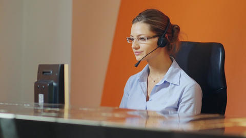 Businesswoman talking on headset in office Stock Video Footage