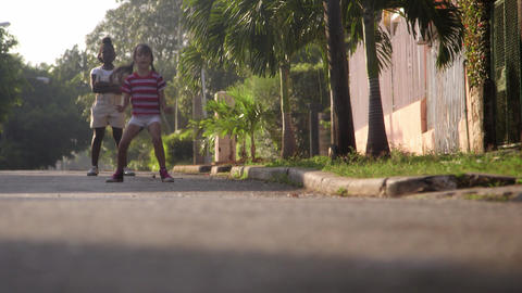 Two happy young girls playing in city street Stock Video Footage