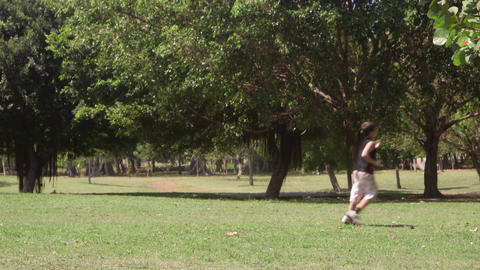 Group of male friends running and playing during recreation Stock Video Footage